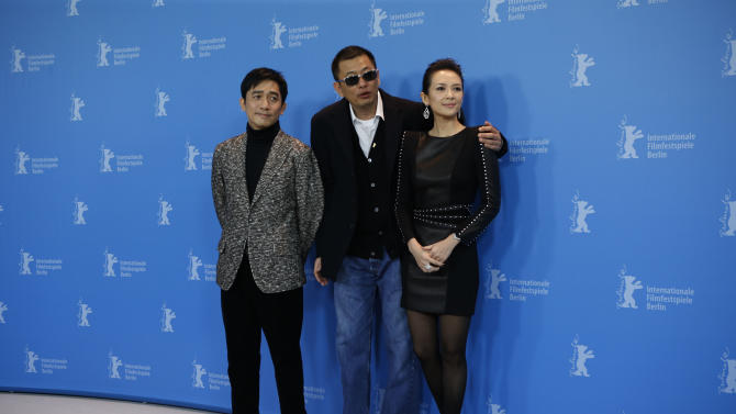 Actor Tony Leung, Director Wong Kar Wai and actress Zhang Ziyi pose for photographers at the photo call for the film The Grandmaster at the 63rd edition of the Berlinale, International Film Festival in Berlin, Thursday, Feb.7,2013. (AP Photo/Gero Breloer)