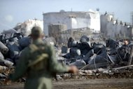&lt;p&gt;A Venezuelan soldier watches the devastation caused by a blaze in the Venezuelan Amuay oil refinery, part of the Paraguana Oil Refining Complex in Paranagua, Venezuela.&lt;/p&gt;