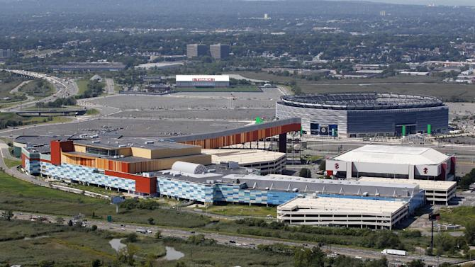 """FILE- In this Thursday, Sept. 1, 2011 file photo, MetLife Stadium, rear right, and the Izod Center, middle right, are seen behind American Dream, formerly called Xanadu, the unfinished oddly patterned shopping and entertainment complex in East Rutherford, N.J. DreamWorks Animation, the Hollywood studio that created the green ogre, Shrek and the wisecracking zoo animals of """"Madagascar"""" has announced plans for an indoor themepark as part of the megamall in New Jersey's Meadowlands. DreamWorks Animation CEO Jeffrey Katzenberg says the themepark 10 miles west of New York City will incorporate the studio's characters and storytelling. (AP Photo/Mel Evans, File)"""