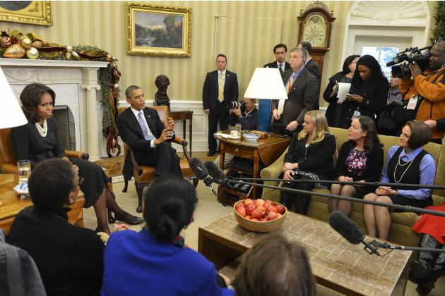 U.S. President Obama speaks to mothers after discussing how Obamacare can help families plan their health care, in the White House in Washington