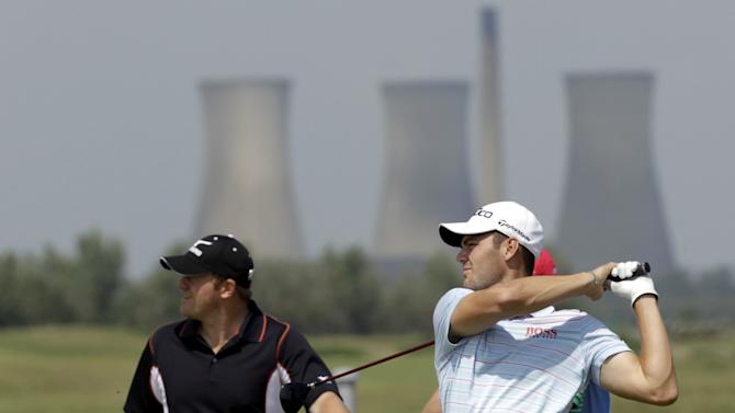 Germany's Martin Kaymer tees off on the 14th  hole during a practice round at  Royal St. George's Golf Club, Sandwich, England, Monday, July, 11, 2011.  The British Open Golf Championship will be held at the course from July 14-17th 2011.  (AP Photo/Peter Morrison)