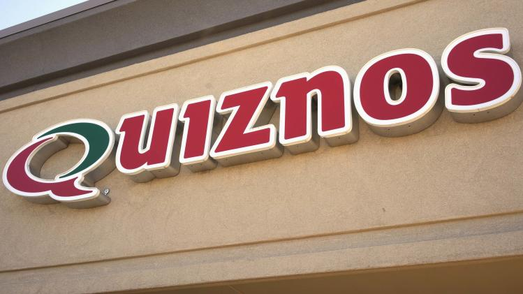 The sign of a Quiznos store is seen in Westminster, Colorado