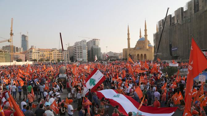 Supporters of the Free Patriotic Movement (FPM) carry flags during a protest in Beirut, Lebanon