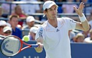 Andy Murray of Britain shows the strain as he returns to Feliciano Lopez of Spain during their men&#39;s singles match at the 2012 US Open tennis tournament in New York. Murray needed almost four hours to clinch a 7-6 (7/5), 7-6 (7/5), 4-6, 7-6 (7/4) victory