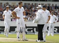 Umpire Steve Davis (right) talks to England's Steven Finn after he calls a dead ball during the second international test cricket match between England and South Africa at Headingley Carnegie in Leeds. England endured a frustrating morning after sending South Africa in to bat on the first day of the second Test at Headingley