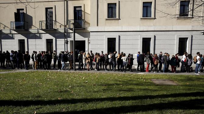 Students queue to attend the debate between Ciudadanos party leader Rivera and Podemos (We Can) party leader Iglesias at Carlos III University in Leganes, outside Madrid