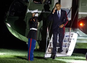 President Barack arrives on the South Lawn of the White…