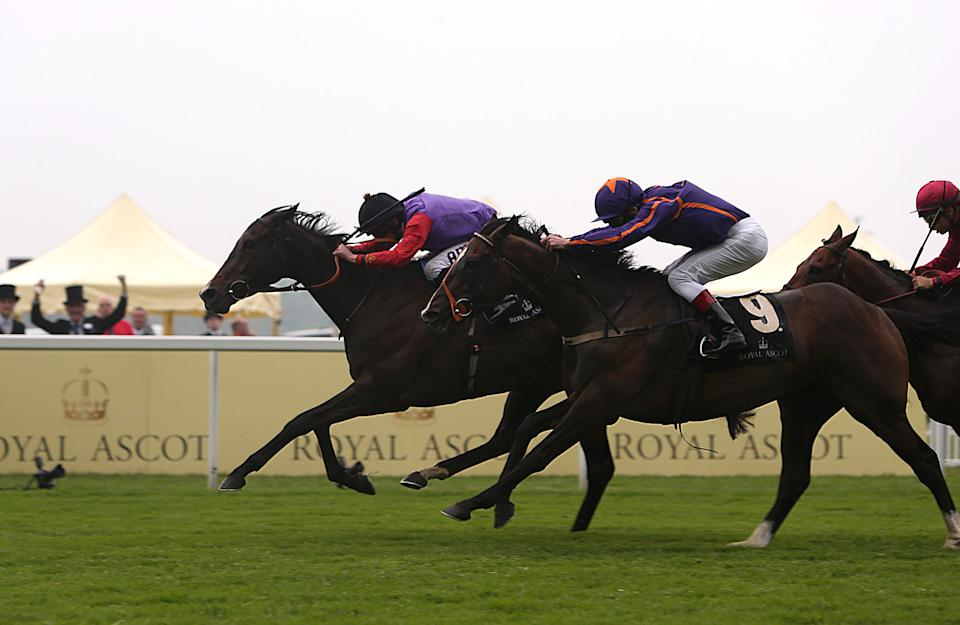 Estimate ridden by jockey Ryan Moore wins the Gold Cup ahead of Simenon ridden by jockey Johnny Murtagh, center, on day three of the Royal Ascot horse race meeting in Ascot, England, Thursday, June 20, 2013. (AP Photo/PA, Steve Parsons) UNITED KINGDOM OUT NO SALES NO ARCHIVE