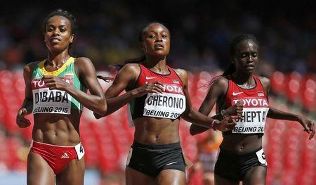 Dibaba and Kiprop coast, holder Reese out of long jump