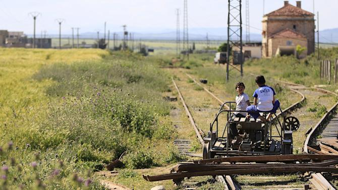 Children play on the railway tracks at Tell i-Refat train station in the northern countryside of Aleppo