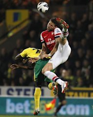 Arsenal&#39;s player Olivier Giroud (R) challenges Norwich City&#39;s Alexander Tettey during an English Premier League football match between at Carrow Road stadium in Norwich, England. Norwich won 1-0