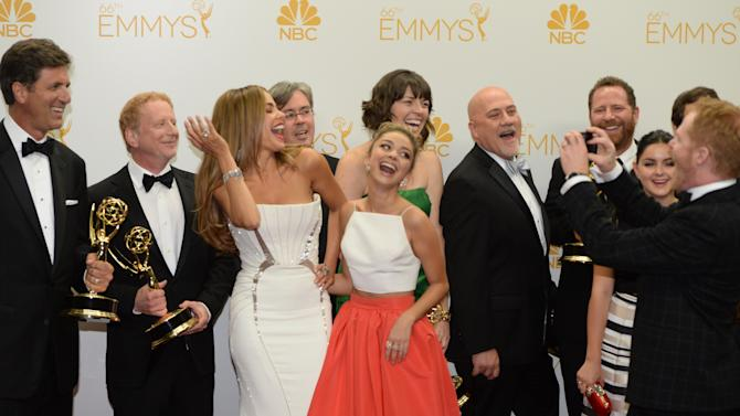 """Actresses Sofía Vergara (L) and Sarah Hyland (R) pose in the press room after winning the Outstanding Comedy Series Award for """"Modern Family"""" during the 66th Emmy Awards, August 25, 2014 at the Nokia Theatre in downtown Los Angeles"""