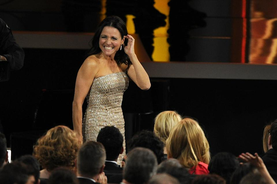 "Julia Louis-Dreyfus reacts as it was announced that she won the award for outstanding lead actress in a comedy series for her role on ""Veep"" at the 65th Primetime Emmy Awards at Nokia Theatre on Sunday Sept. 22, 2013, in Los Angeles. (Photo by Chris Pizzello/Invision/AP)"