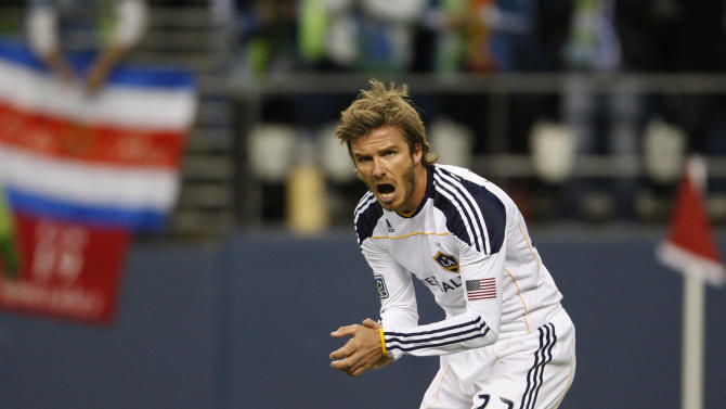 Los Angeles Galaxy's David Beckham encourages a teammate during the first half of a MLS playoff soccer game against the Seattle Sounders on Sunday, Oct. 31, 2010 in Seattle. Los Angeles defeated Seattle 1-0. (AP Photo/Kevin P. Casey)