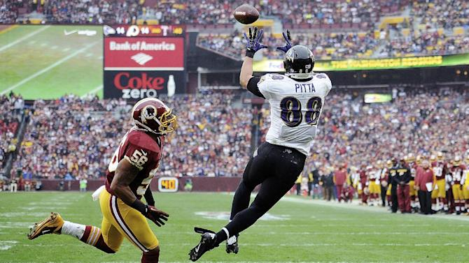 Washington Redskins inside linebacker Perry Riley (56) watches as Baltimore Ravens tight end Dennis Pitta (88) pulls in a touchdown pass during the first half of an NFL football game in Landover, Md., Sunday, Dec. 9, 2012. (AP Photo/Nick Wass)