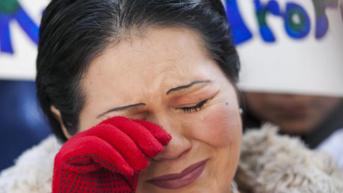 FILE - In this Feb. 15, 2013, file photo, Plaintiff Alicia Cerbantes wipes a tear as she talks to the media, at the Frank E. Moss Federal Courthouse, in Salt Lake City. U.S. District Court Judge Clark Waddoups was hearing final oral arguments on constitutionality of HB497, Utah's immigration enforcement law passed by the Utah Legislature in 2011. A federal judge has issued a split ruling on Utah's controversial immigration law, upholding one key measure but striking down several others. U.S. District Judge Clark Waddoups' ruling Wednesday upheld a key provision requiring authorities to check the immigration status of people arrested for felonies or Class A misdemeanors, such as theft. But he set limits on how it can be implemented. (AP Photo/The Deseret News, Scott G. Winterton, File) SALT LAKE TRIBUNE OUT; MAGS OUT