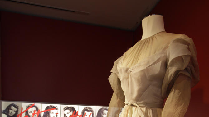 """A gown by Valentina, from the 1942 production of """"Without Love,"""" is shown as part of the """"Katharine Hepburn: Dressed for Stage and Screen"""" exhibit in the New York Public Library for the Performing Arts at Lincoln Center,  Tuesday, Oct. 16, 2012. (AP Photo/Richard Drew)"""