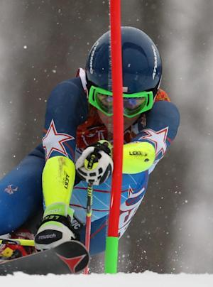 United States' Mikaela Shiffrin approaches a gate in the first run of the women's giant slalom at the Sochi 2014 Winter Olympics, Tuesday, Feb. 18, 2014, in Krasnaya Polyana, Russia