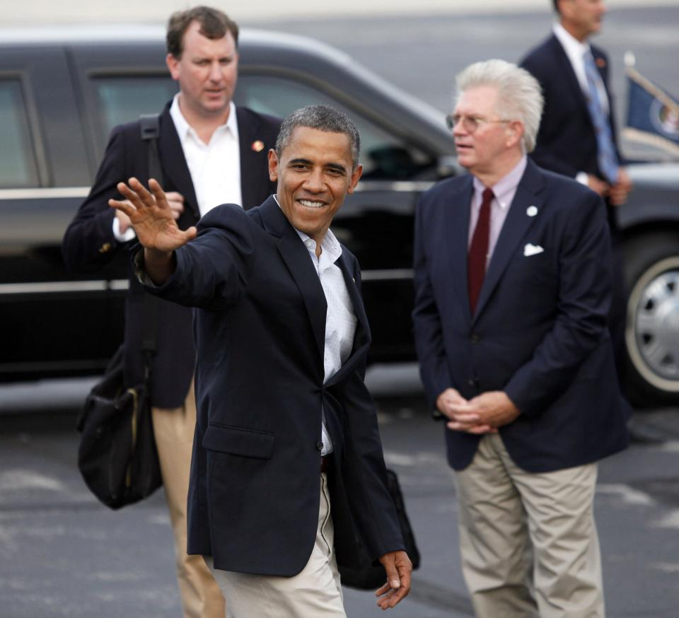 President Obama heads to his car after arriving at Toledo Express Airport in Swanton, Ohio, Sunday, Sept. 2, 2012.   (AP Photo/Madalyn Ruggiero)