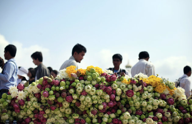 People mourn the death of former King Norodom Sihanouk at the Royal Palace in Phnom Penh, Cambodia, Wednesday Oct. 17, 2012. Sihanouk, a cunning political survivor who reinvented himself repeatedly throughout his often flamboyant life, died Monday at age 89 of a heart attack in Beijing, where he had been receiving medical treatment since January for multiple ailments. (AP Photo/Wong Maye-E)
