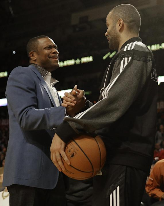 Actor Chris Tucker, left and West Team's Tony Parker, of the San Antonio Spurs speak before the NBA All Star basketball game, Sunday, Feb. 16, 2014, in New Orleans