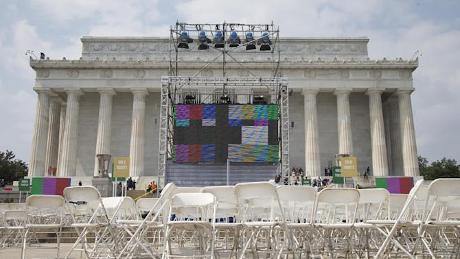 "Chairs, metal risers and video screens are set up at the Lincoln Memorial in Washington, Tuesday, Aug. 27, 2013, in preparation for the 50th anniversary of the March On Washington celebrations that will be held Wednesday, Aug, 28, 2013. Barack Obama, who is going to speak, was 2 years old and growing up in Hawaii when Martin Luther King Jr. delivered his ""I Have a Dream"" speech from the steps of the Lincoln Memorial. Fifty years later, the nation's first black president will stand as the most high-profile example of the racial progress King espoused, delivering remarks at a nationwide commemoration of the 1963 demonstration for jobs, economic justice and racial equality. (AP Photo/Carolyn Kaster)"