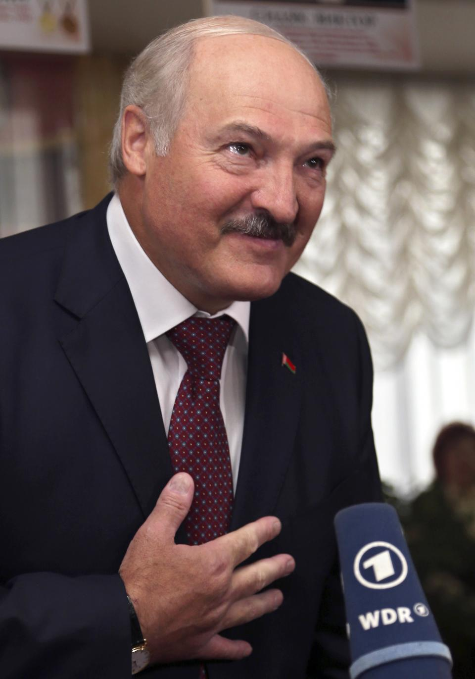 Belarusian President Alexander Lukashenko, at a polling station after voting during parliamentary elections in Minsk, Belarus, Sunday, Sept. 23, 2012. Belarus is holding parliamentary elections Sunday without the main opposition parties, which boycotted the vote to protest the detention of political prisoners and opportunities for election fraud. (AP Photo/Sergei Grits)