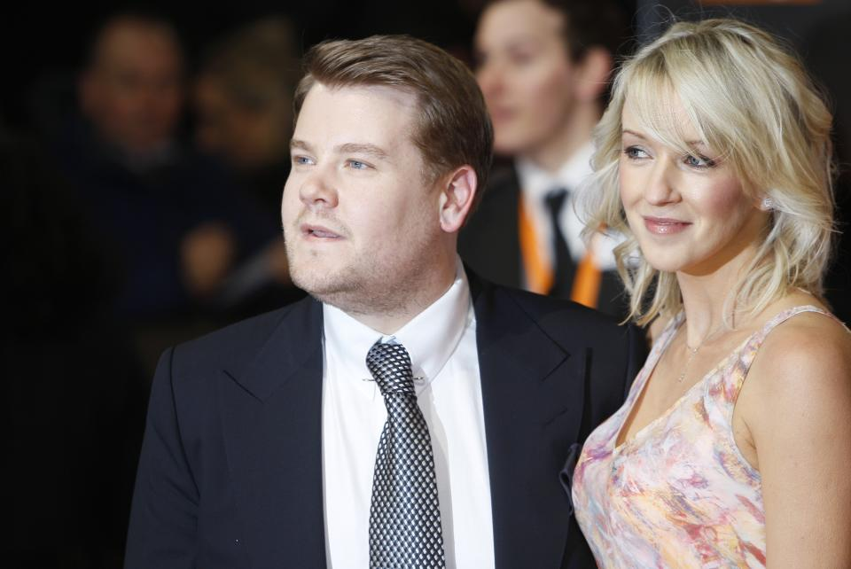 Actor James Corden with partner Julia Carey arrives for the BAFTA Film Awards 2012, at The Royal Opera House in London, Sunday, Feb. 12, 2012. (AP Photo/Alastair Grant)