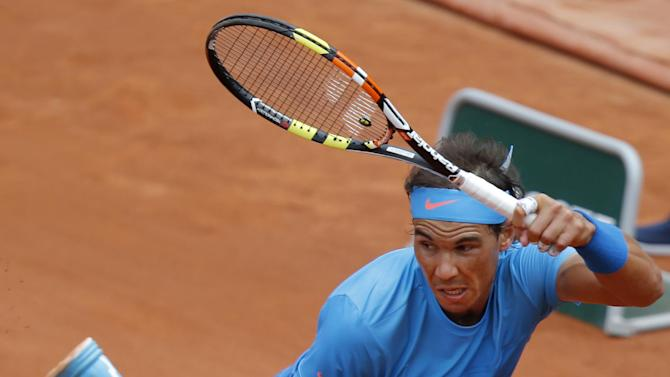 Spain's Rafael Nadal returns in the first round match of the French Open tennis tournament against Quentin Halys of France at the Roland Garros stadium, in Paris, France, Tuesday, May 26, 2015. Nadal won in three sets 6-3, 6-3, 6-4. (AP Photo/Michel Euler)