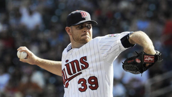 Minnesota Twins' P.J. Walters throws to a Detroit Tigers batter during the first inning of a baseball game Saturday, Sept. 29, 2012 in Minneapolis. (AP Photo/Jim Mone)