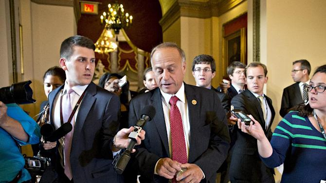 Rep. Steve King, R-Iowa, walks from House Speaker John Boehner's office with reporters in pursuit, at the Capitol in Washington, Tuesday, Oct. 15, 2013. Time growing desperately short, House Republicans pushed for passage of legislation late Tuesday to prevent a threatened Treasury default, end a 15-day partial government shutdown and extricate divided government from its latest brush with a full political meltdown. (AP Photo/J. Scott Applewhite)