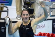 France&#39;s Camille Muffat celebrates after the women&#39;s 400m freestyle final swimming event at the London 2012 Olympic Games in London. Muffat won gold