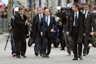 France&#39;s president-elect Francois Hollande (C) arrives to take part in a ceremony marking the 67th anniversary of the Allied victory over Nazi Germany in World War II, in Paris. Hollande formally takes office on May 15 and shortly thereafter travels to Germany for his meeting with Merkel