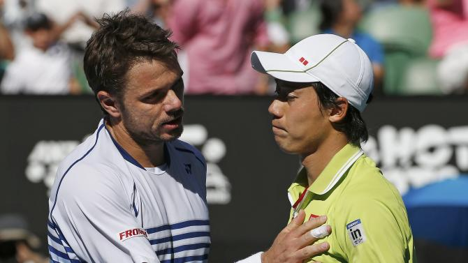 Wawrinka of Switzerland shakes hands with Nishikori of Japan after winning their men's singles quarter-final match at the Australian Open 2015 tennis tournament in Melbourne
