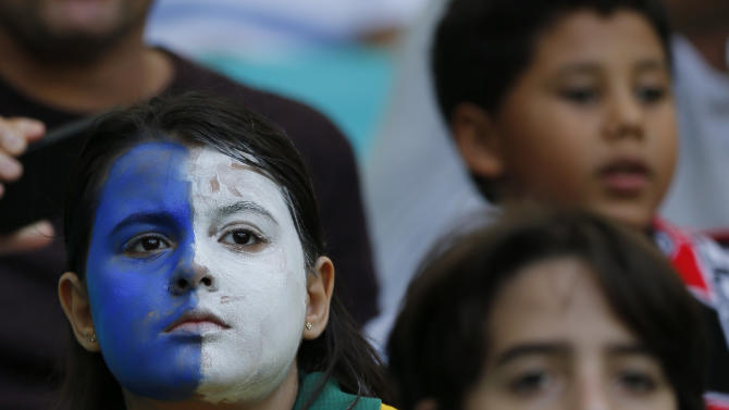 A fan of Uruguay waits for the start of the soccer Confederations Cup third-place match between Uruguay and Italy at the Fonte Nova stadium in Salvador, Brazil, Sunday, June 30, 2013. (AP Photo/Fernando Llano)