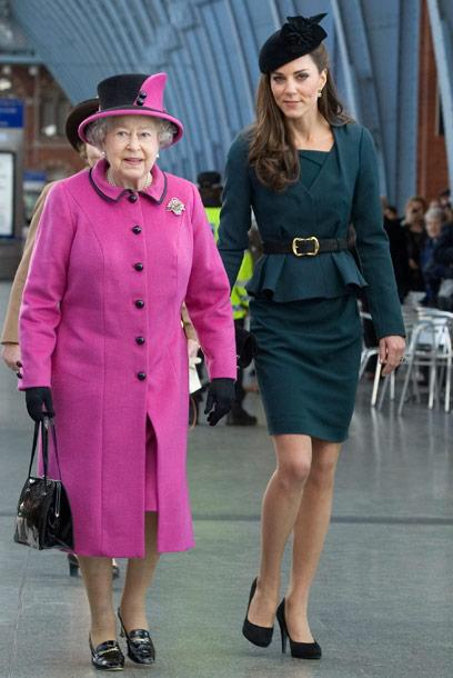 Kate Middleton boards a train with the Queen wearing L.K. Bennett, March 2012