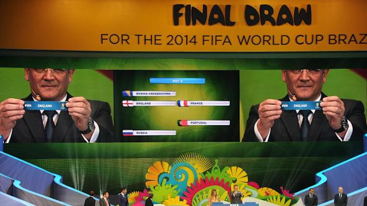 FIFA Secretary General Jerome Valcke draws England, during the final draw of the groups for the Brazil 2014 FIFA World Cup, in Costa do Sauipe, Bahia state, Brazil, on December 6, 2013