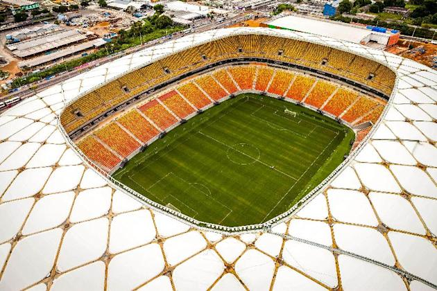 This photo released by Portal da Copa shows Arena da Amazonia stadium on the day of its inauguration in Manaus in the state of Amazonas, Brazil, Sunday, March 9, 2014. Three stadiums still have to be