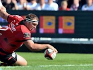 Toulon's hooker Jean-Charles Orioli scores a try during their French Top 14 rugby union against Castres at the Mayol stadium in Toulon, southern France. Toulon won 33-12