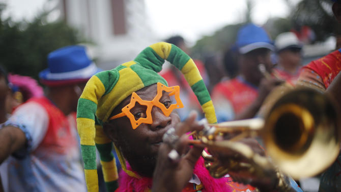 "A musician plays a trumpet during the Banda de Ipanema carnival parade in Rio de Janeiro, Brazil, Saturday, Jan. 31, 2015. Rio's over-the-top Carnival is the highlight of the year for many local residents. Hundreds of thousands of merrymakers will begin to take to the streets in open-air ""blocos"" parties. (AP Photo/Silvia Izquierdo)"