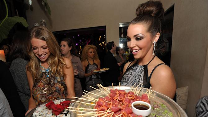 """Stassi Schroeder and Scheana Marie attend the premiere party for """"Vanderpump Rules"""" at SUR restaurant, on Monday, Dec. 10, 2012 in Los Angeles. The show premieres on January 7, 2013 on Bravo.  (Photo by John Shearer/Invision for Bravo/ AP Images)"""