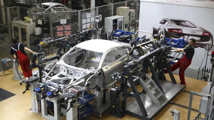 File photo of workers assembling new Audi R8 car body