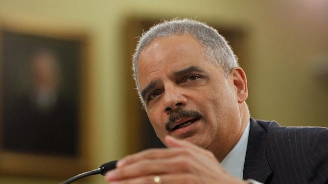 Attorney General Eric Holder testifies on Capitol Hill in Washington, Thursday, April 18, 2013, before the House Appropriations Committee hearing on the Justice Department's fiscal 2014 budget.   (AP Photo/Molly Riley)