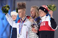 (From L) Norway's silver medalist Staale Sandbech, US gold medalist Sage Kotsenburg and Canada's bronze medalist Mark Mcmorris pose on the podium of the Men's Snowboard Slopestyle event of the Sochi Winter Olympics on February 8, 2014