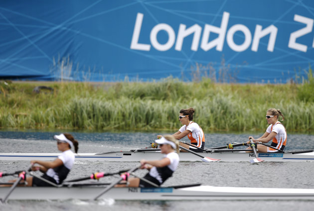 Netherlands' Maaike Head and Rianne Sigmond, in background, pass New Zealand's Julia Edward, left, and Louise Ayling to win a lightweight women's rowing double sculls repechage in Eton Dorney, near Windsor, England, at the 2012 Summer Olympics, Tuesday, July 31, 2012. New Zealand arrived second. (AP Photo/Natacha Pisarenko)