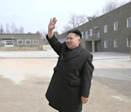 A picture from North Korea's official Korean Central News Agency shows leader Kim Jong-Un visiting Panmunjom village on the border between North and South Korea. Sometimes mail between South and North Korea is thrown over a river tied to a rock