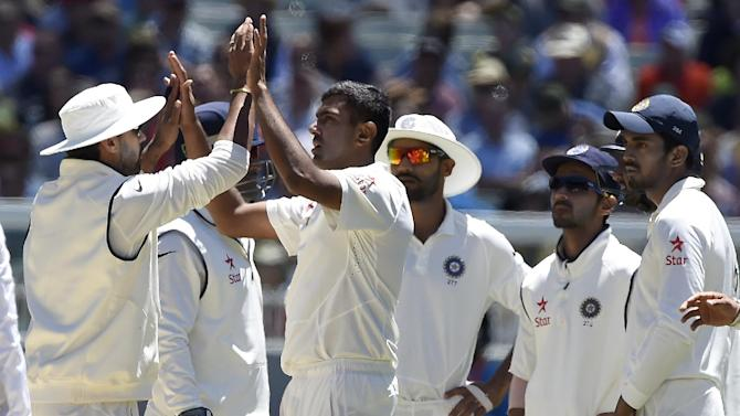 Indian players celebrate the wicket of Australia's Mitchell Johnson for 28 runs on the second day of their cricket test match in Melbourne, Australia, Saturday, Dec. 27, 2014. (AP Photo/Andy Brownbill)
