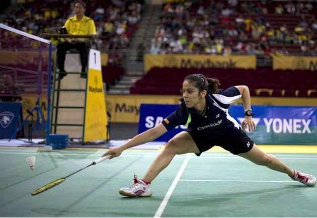Saina Nehwal of India returns a shot aga