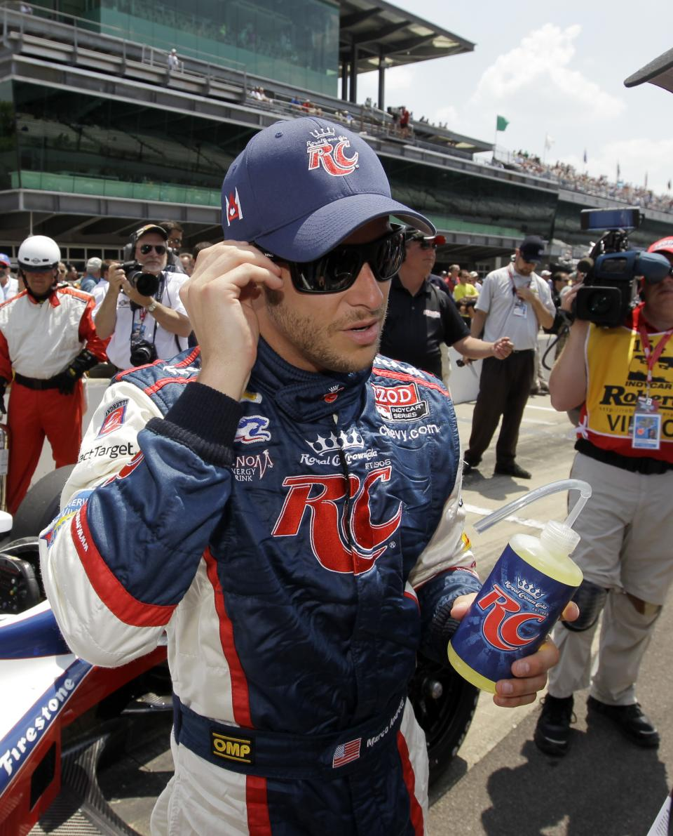 IndyCar driver Marco Andretti adjusts his hat after he qualified on the first day of qualifications for the Indianapolis 500 auto race at the Indianapolis Motor Speedway in Indianapolis, Saturday, May 19, 2012. (AP Photo/Darron Cummings)