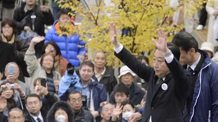 Prime Minister Yoshihiko Noda of the ruling Democratic Party of Japan waves at his party supporters during parliamentary elections campaign in Iwaki, Fukushima Prefecture, Japan, Tuesday, Dec. 4, 2012. Leaders for Japan's biggest political parties kicked off the campaign Tuesday for parliamentary elections to be held in less than two weeks with visits to nuclear crisis-hit Fukushima prefecture. (AP Photo/Kyodo News) JAPAN OUT, MANDATORY CREDIT, NO LICENSING IN CHINA, FRANCE, HONG KONG, JAPAN AND SOUTH KOREA
